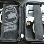 Use a hard drive case to hold cables and adapters